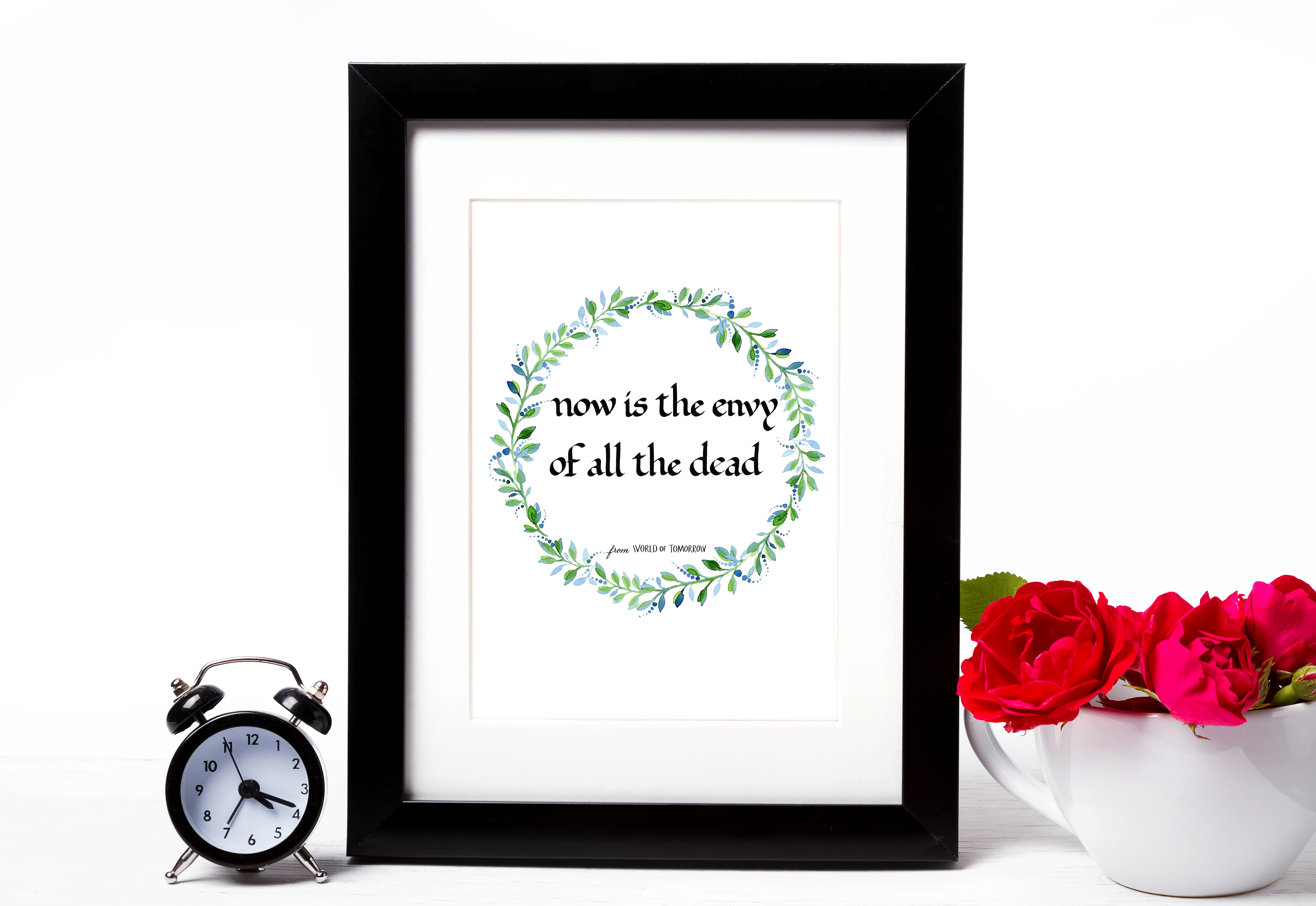 Empty frame mock-up, red roses in a cup and clock